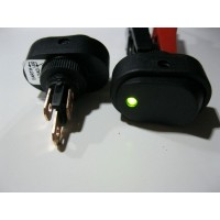OVAL ROCKER SWITCH 12 VOLT. ILLUMINATED GREEN